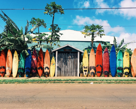 All-inclusive resorts include activities like surfing.