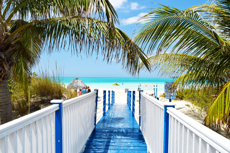 Cuba all-inclusive vacation boardwalk to beach.