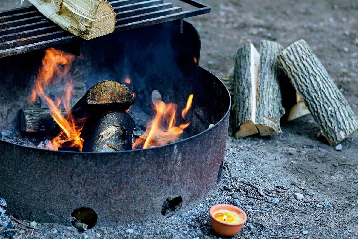 Enjoying a camp fire.