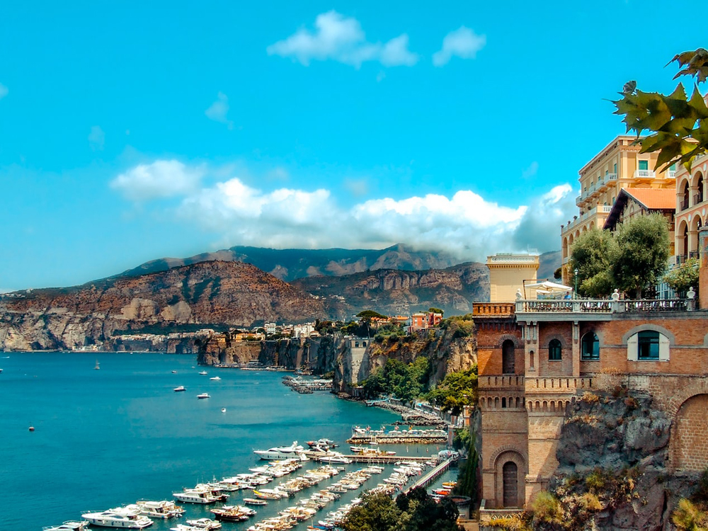 Seaside village overlooking a marina and cliffs