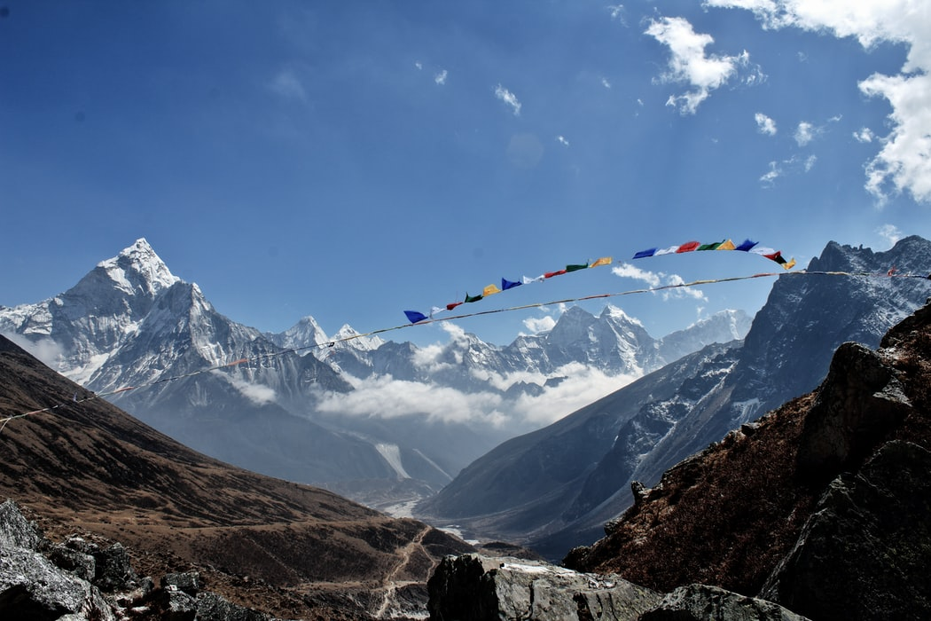 Snowcapped mountains and colourful flags blowing in the wind