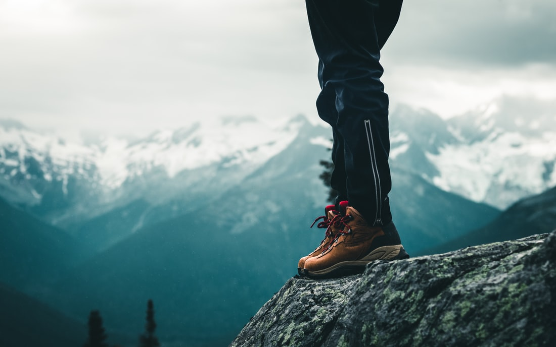 Someone hiking on the edge of a mountain