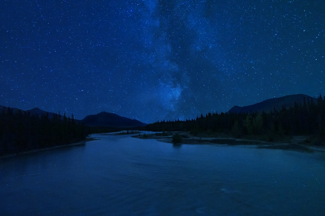 A starry night by a mountain lake
