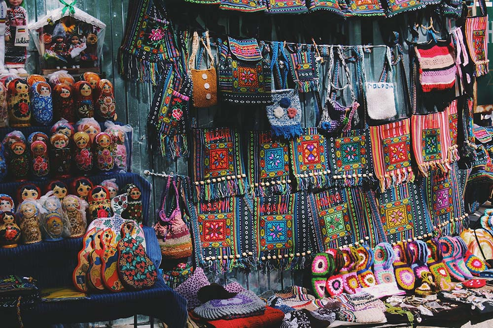 Russian dolls and purses in marketplace.