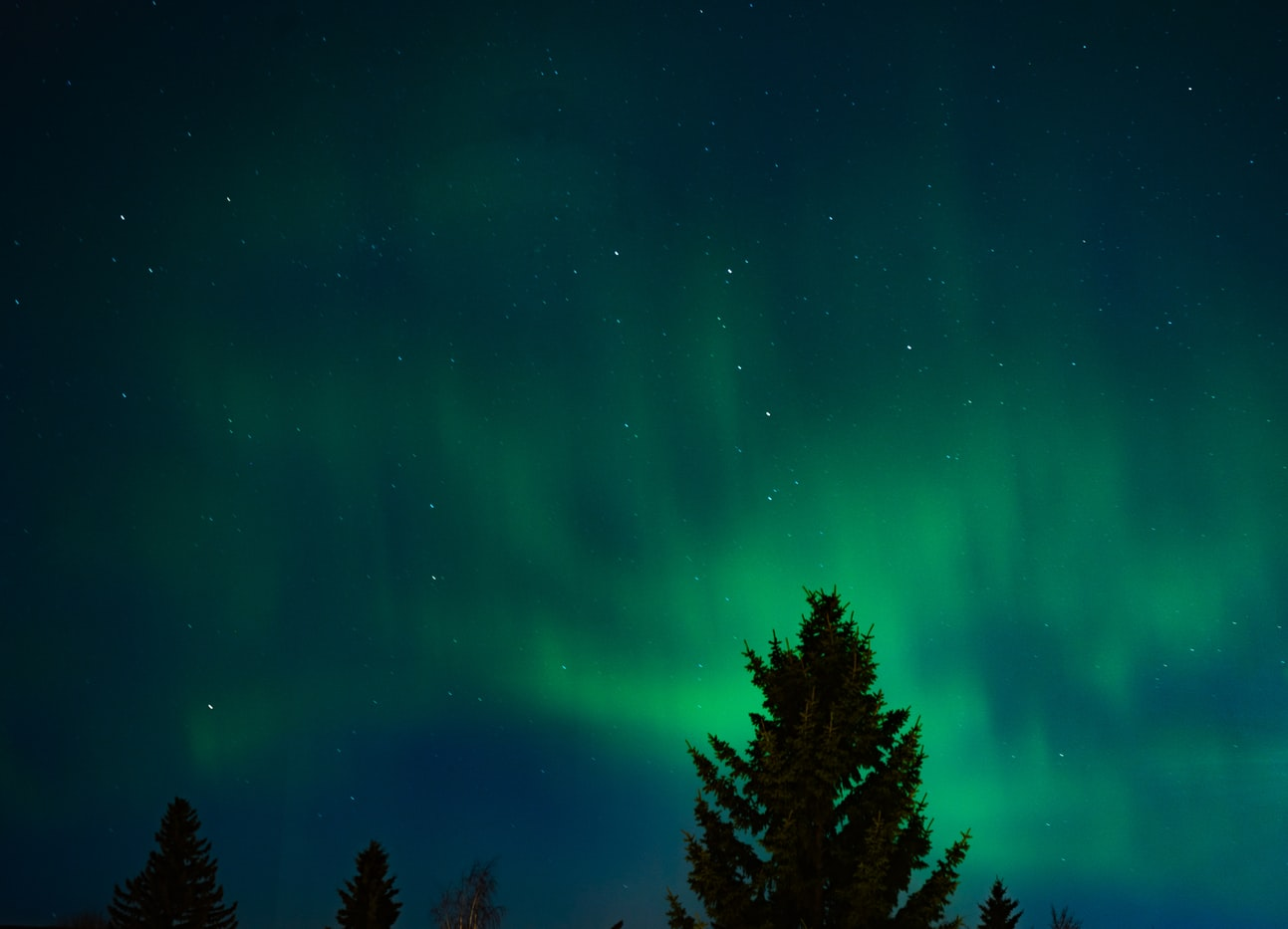 Colorful northern lights and a sky full of stars