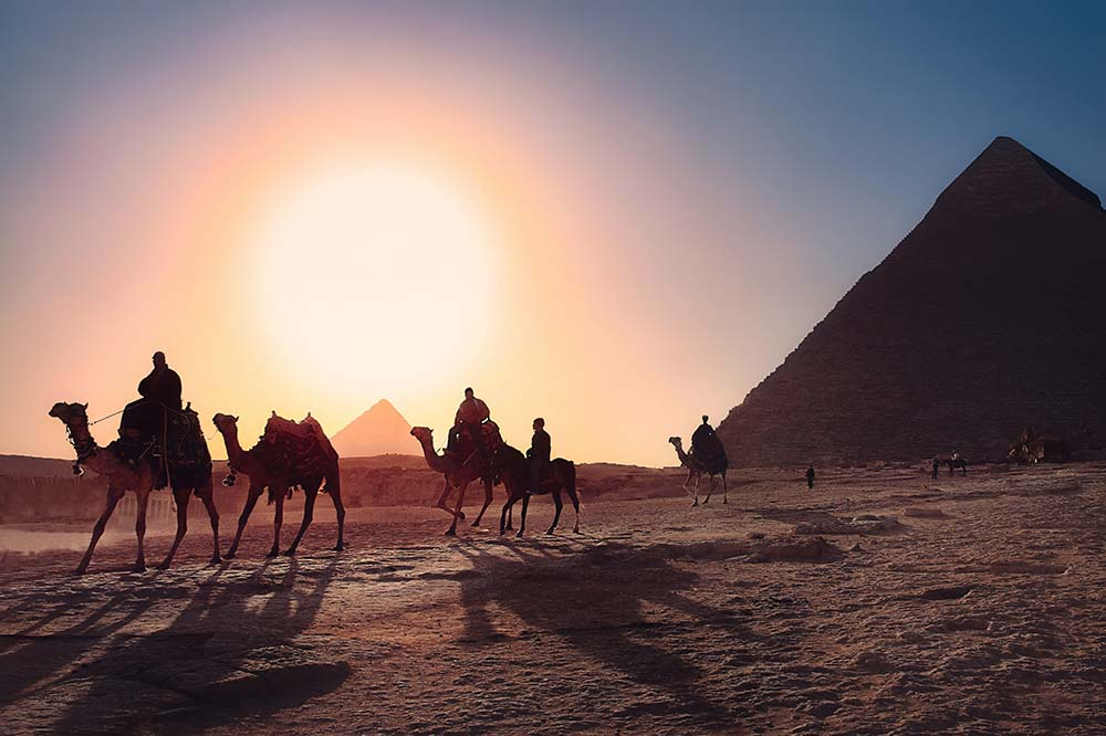 Visit the Great Pyramids of Giza.