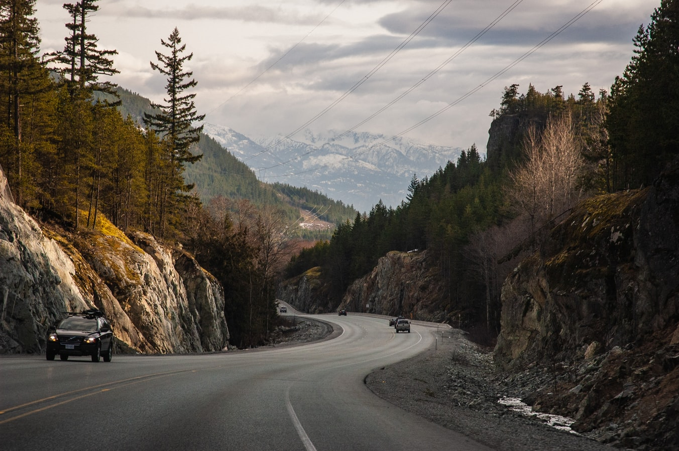 Cars driving down a mountainous road