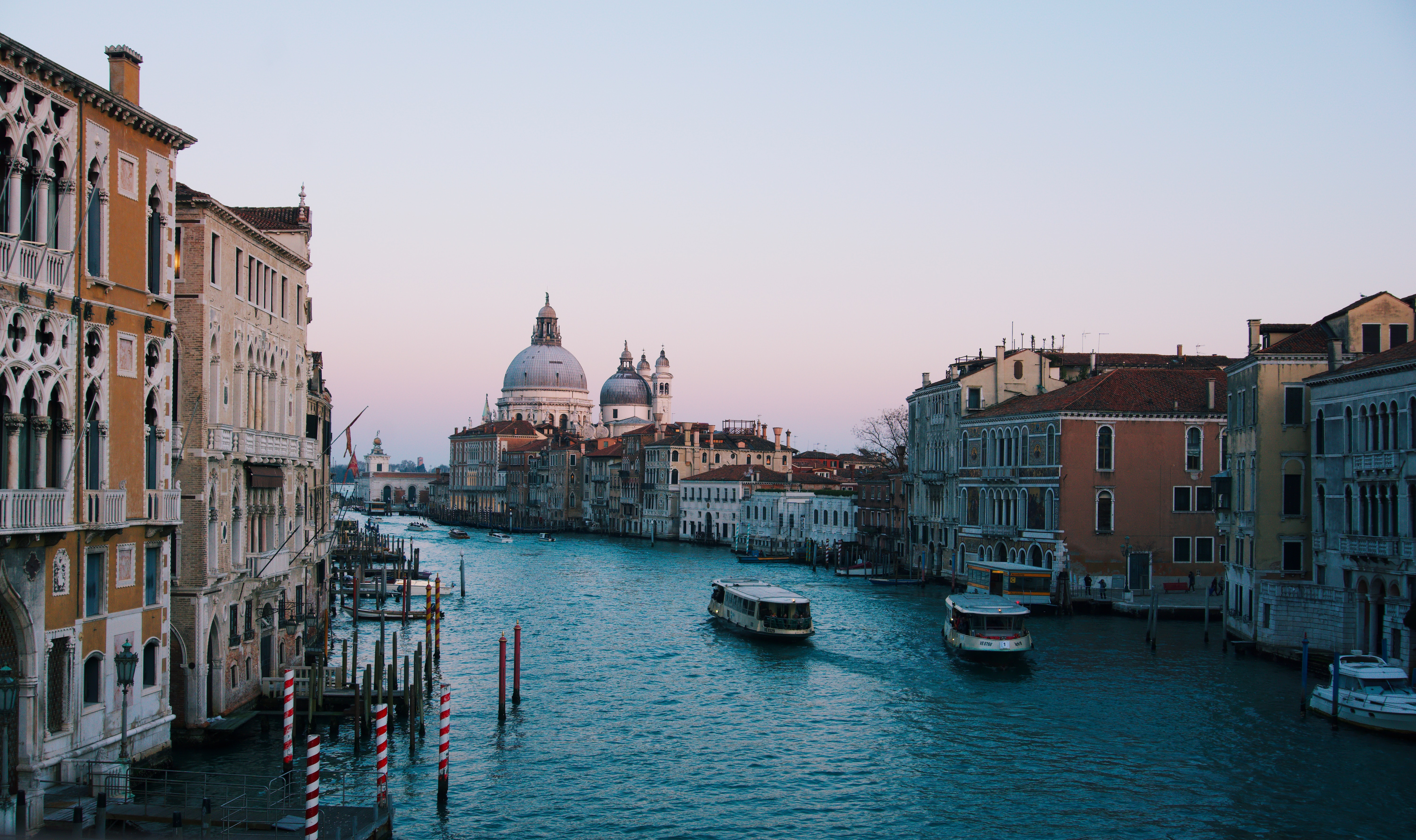 River cruises travel Grand Canal in Venice.