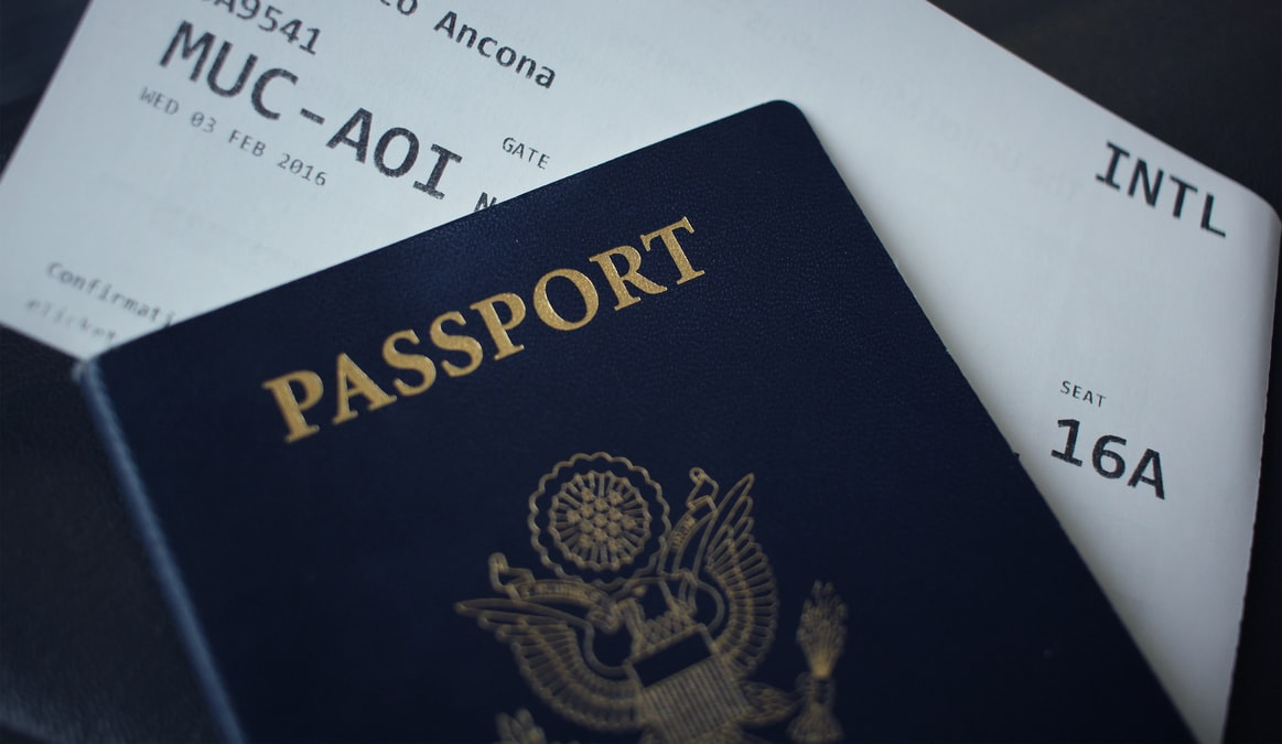 Close up of a boarding pass and a passport
