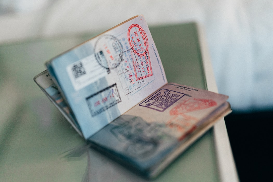 Passport open with stamps on the pages