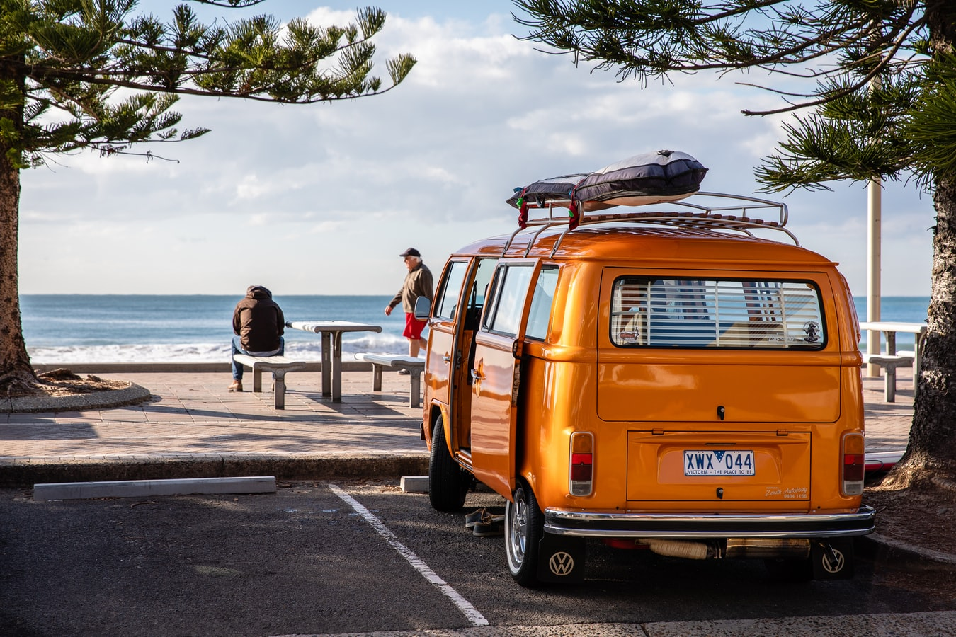 Yellow van parked by a beach