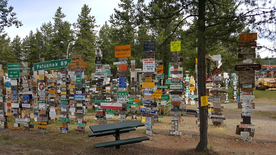 A lot of road signs and license plates displayed outside