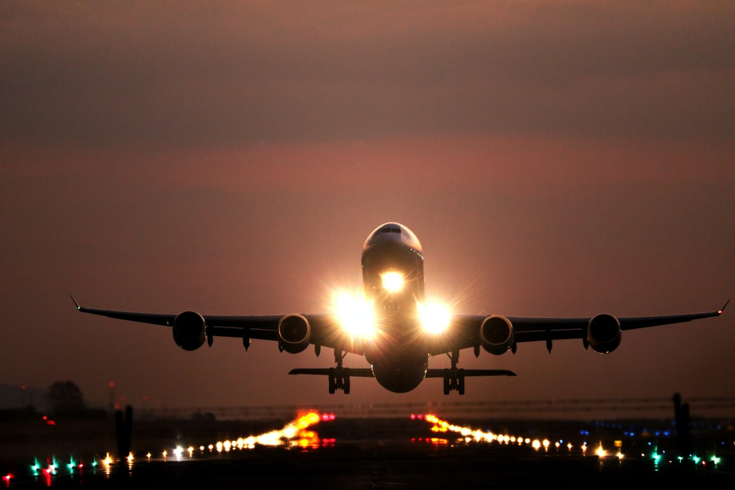 A plane taking off at sunset